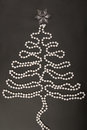 White new year s tree on black garland is background Royalty Free Stock Photo