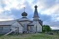 White nights on the Kola Peninsula. Old wooden Church in the village of Varzuga Royalty Free Stock Photo