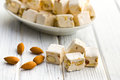 White nougat with almonds on wooden table Stock Image