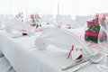 White nuptial decorated wedding table with napkin and flowers Stock Photography