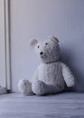 White old fashioned teddy bear sitting alone home Royalty Free Stock Photo