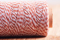 White orange baking twine roll closeup horizontal Stock Photos