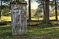 White outhouse rural setting Stock Images