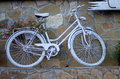White painted bicycle with flowers Royalty Free Stock Images