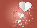 White paper heart and trees on red shadow background .