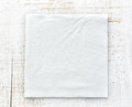 White paper napkin on wooden table Royalty Free Stock Photography