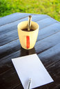 White paper note with pen with coffee cup on the table dark brown Stock Images