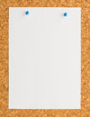 White paper note sheet with blue push pin on cork board Royalty Free Stock Photo