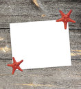 White paper note with starfish in the summer vacation season. Royalty Free Stock Photo