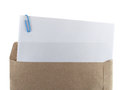 White paper and paperclip in brown envelope Royalty Free Stock Photo