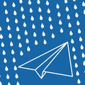 white paper plane with rain drops on a blue air background. Blue sky travel background
