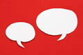 White paper speech bubbles blank with copy space on a red background Royalty Free Stock Images