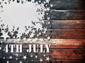 White paper star fourth july on wood Royalty Free Stock Image