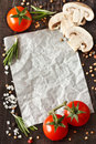 White paper surrounded by food ingredients for note or recipe Stock Photo