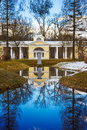 White pavilion and lake in the park of Pavlovsk on the spring su Royalty Free Stock Photo