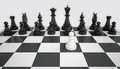 White pawn before the army of black chess pieces gray background Royalty Free Stock Photo