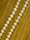 White pearls natural on green background Royalty Free Stock Photos