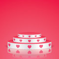 White pedestal with pink hearts.