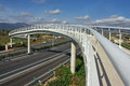 White pedestrian bridge over a highway in majorca spain Stock Photo