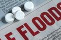 White pill put on newspaper Stock Image