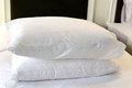 White pillow on white bed comfortable soft Royalty Free Stock Photo
