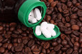 White pills with coffee beans Stock Image