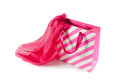 White pink gift bag and pink silk scarf isolated on white bright Royalty Free Stock Image