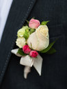 White and pink rose wedding boutonniere on suit Royalty Free Stock Photo