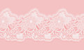 White and pink seamless lace tape on pink background. Floral seamless border for design. Royalty Free Stock Photo