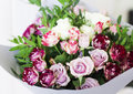 The white and pink spray roses in gray floral paper Royalty Free Stock Photo