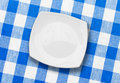 White plate on blue checked fabric tablecloth Stock Photography