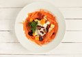 White plate with carrot salad with dried fruits and jogurt Royalty Free Stock Photo