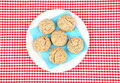 White plate on checked tablecloth filled with buns with sunflower seeds Royalty Free Stock Images