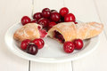 White plate with croissant and cherry Royalty Free Stock Photo