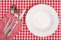 White plate with cutlery of spoon fork and knife Royalty Free Stock Photo