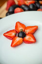 White plate with grapes and strawberries,star form Royalty Free Stock Photo