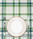 White plate on green checkered tablecloth Stock Photography