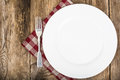 White plate and napkin Serving linen, menu Royalty Free Stock Photo