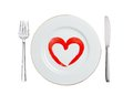 White plate with paint red heart symbol, spoon and fork isolated Royalty Free Stock Photo