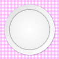 White plate on pink tablecloth empty over checkered background Royalty Free Stock Photos