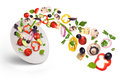 White plate with salad in flight Royalty Free Stock Photo
