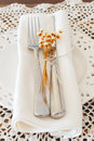 White plate serviette fork knife dried flowers crochet doily Royalty Free Stock Photo