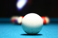 White pool ball in front of the rest which are blurred Stock Photography