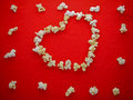 White popcorn on the red cloth with heart pattern