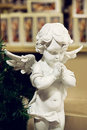 White porcelain figurine of angel Royalty Free Stock Photo