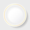 White porcelain plate with gold patterned Stock Photography