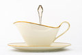 White porcelain sauce boat art deco style manufactured in a gravy or saucière is a shaped pitcher in which Royalty Free Stock Photography