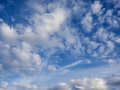 White, puffy clouds in blue sky Royalty Free Stock Photo