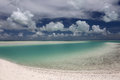 White puffy clouds over turquoise lagoon water kiritimati island Royalty Free Stock Image
