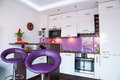 White and purple kitchen interior Royalty Free Stock Image